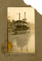 Riverboat with Covered Bridge in Background