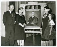 Gathering around the Portrait of Roland B. Daniel