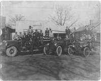 Men Posing in Automobiles in front of Phenix City storefronts